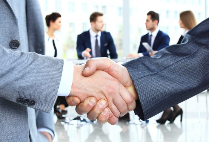 Handshake over a business meeting